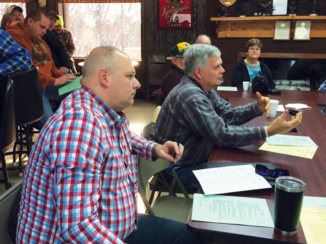 State Rep. Jesse James, R-Altoona, left, and state Sen. Jeff Smith, D-town of Brunswick, right, attended a Dec. 7 meeting of more then 70 residents discussing a proposed expansion of Seven Mike Creek Landfill in the town of Seymour.
