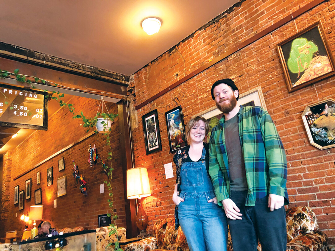 WALL THE POTENTIAL IN THE WORLD. Artfly curators Kelsey Wenberg (left) and Josh Treankler established a gallery at Racy's in Eau Claire along with casual art talks.