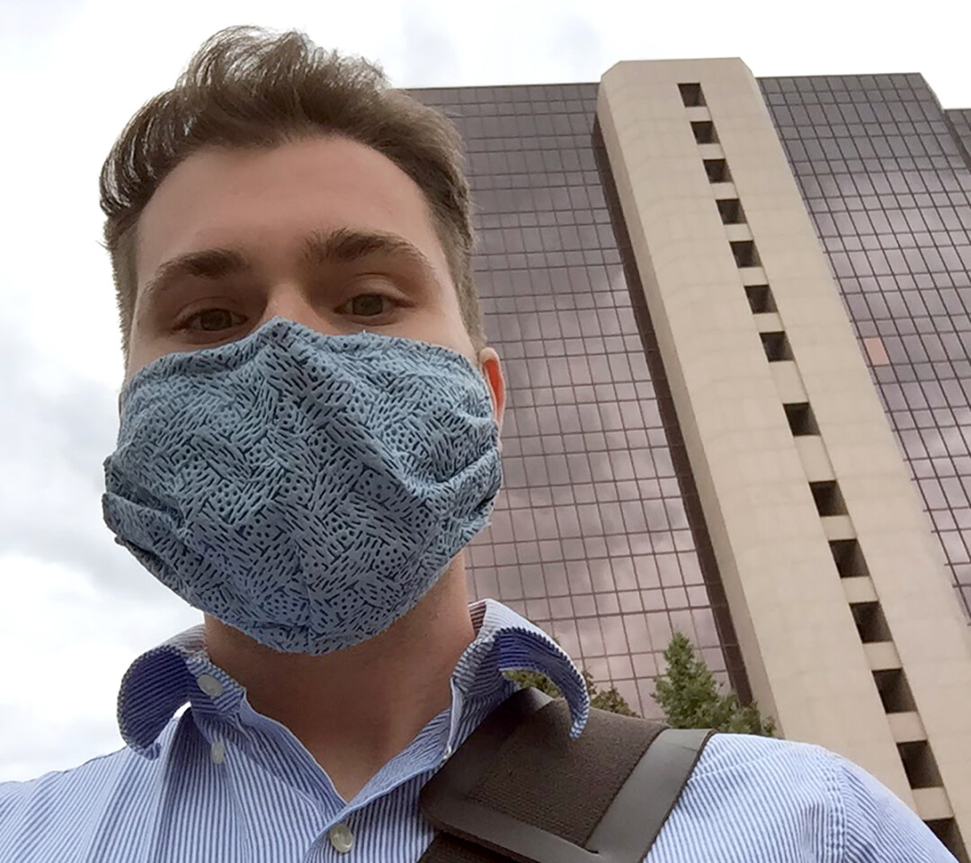 Jack Hemsath wears a protective mask outside Mayo Clinic in Rochester, Minnesota, where he works in the Infectious Diseases Lab.