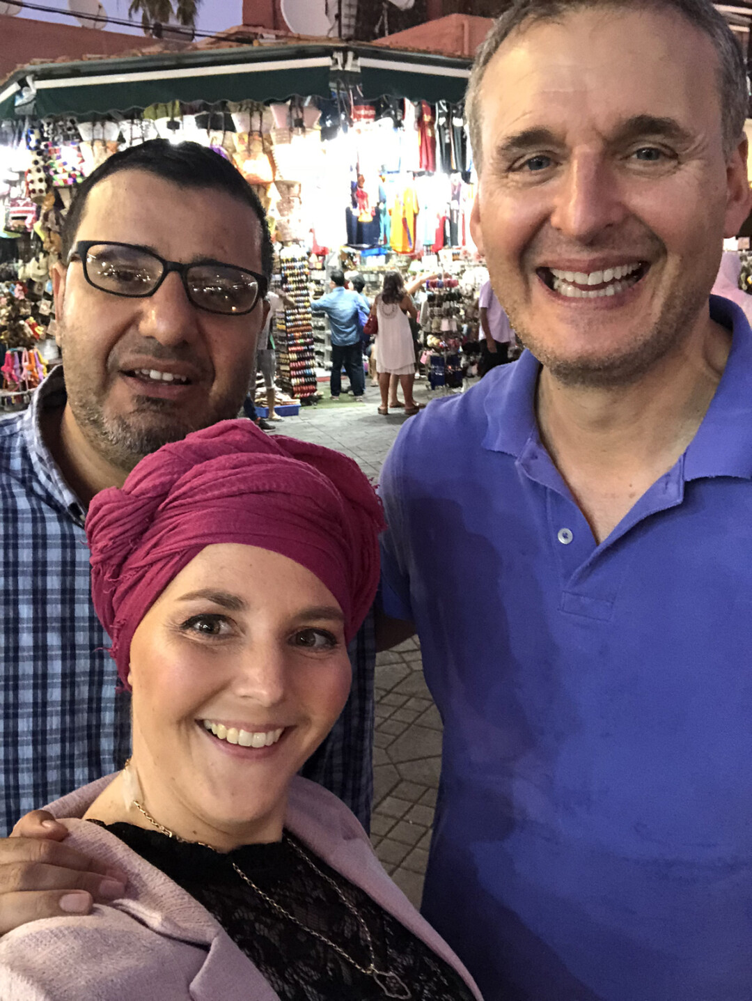 Amanda Mouttaki poses for a picture with her husband and Phil Rosenthal from Somebody Feed Phil.