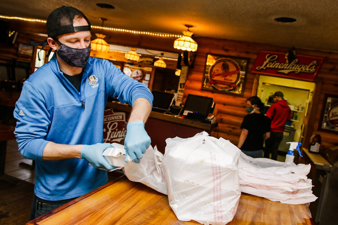 SERVICE WITH A SMILE (BEHIND A MASK). COVID-19 has forced restaurants, such as Loopy's outside Chippewa Falls, to adapt quickly.
