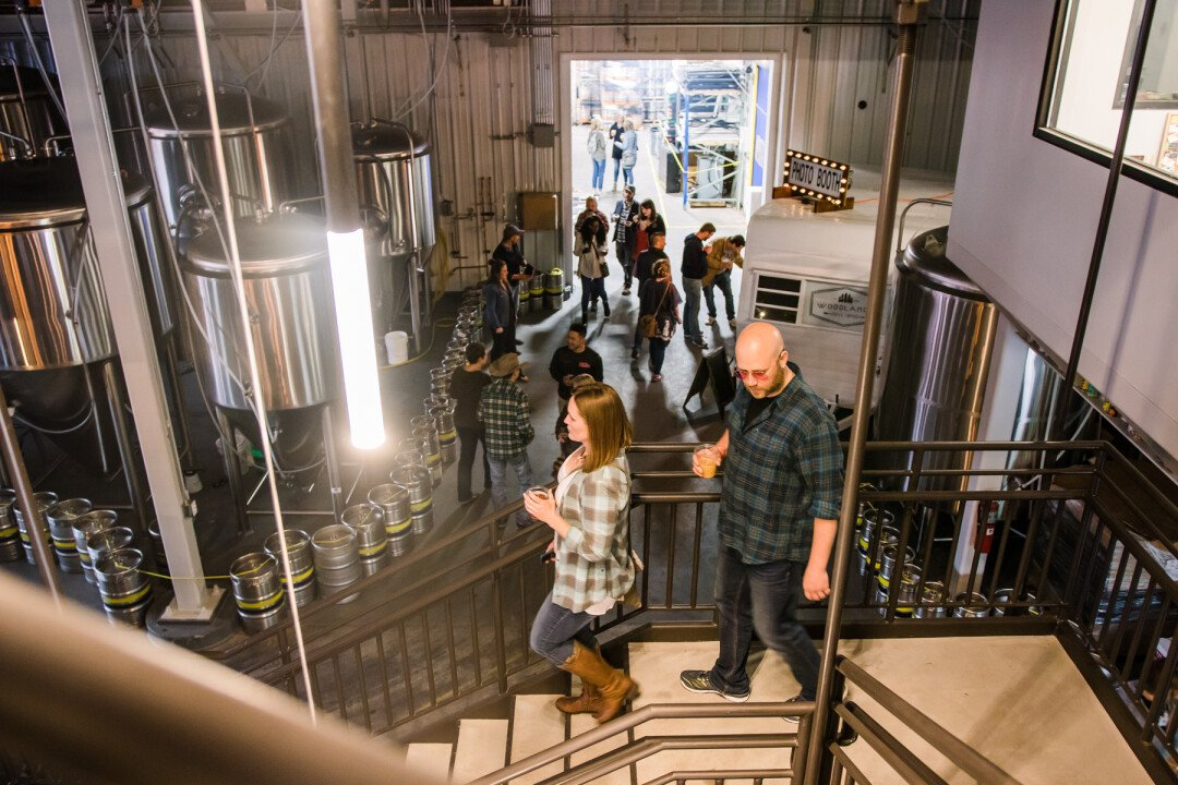 Patrons tour The Brewing Projekt, 1807 N. Oxford Ave., during a grand opening celebration in May 2019.