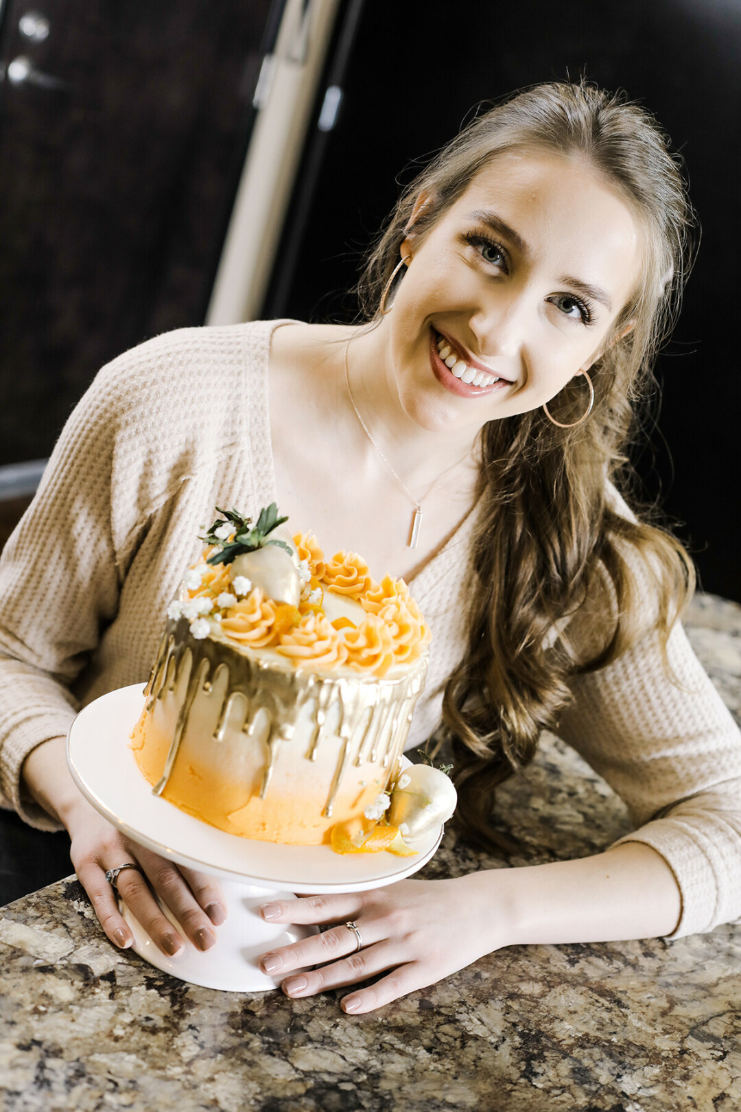 UW-Eau Claire student Michayla Thielen creates amazing baked goods like this orange dreamsicle cake.