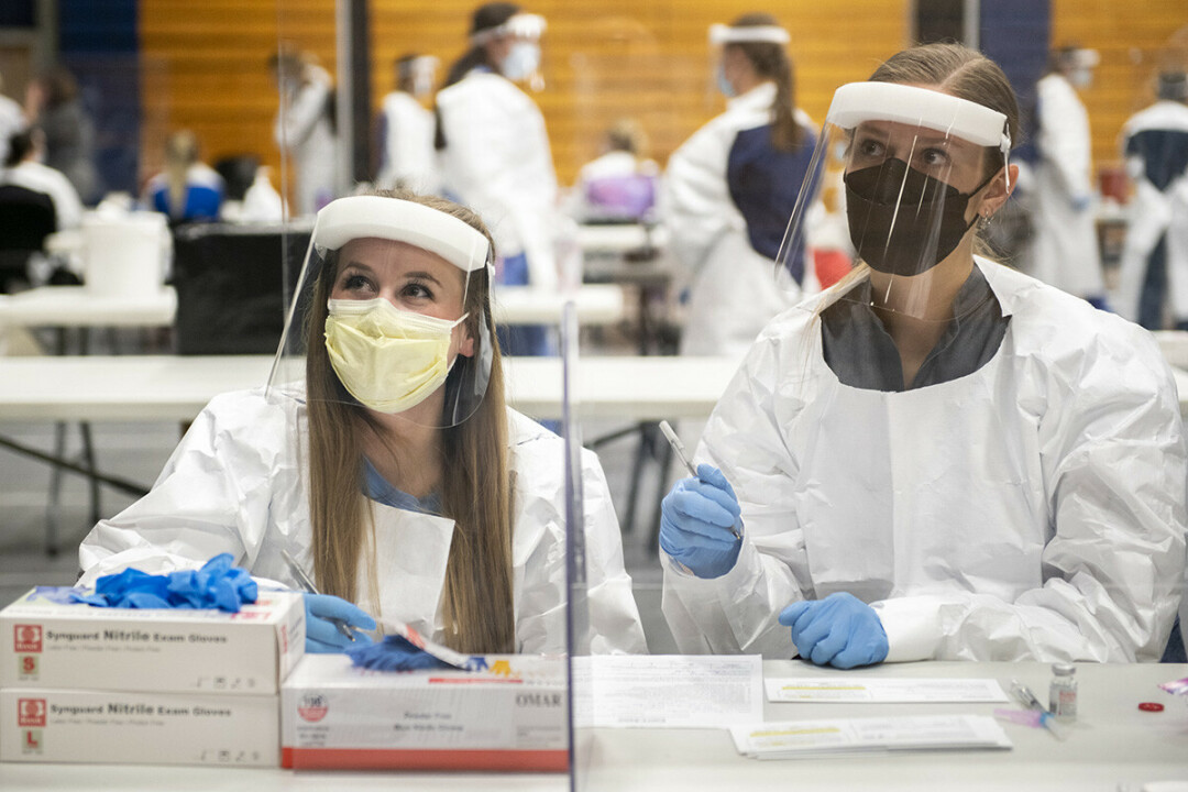 Senior nursing students Briunna Wells (left) and Amanda Koenig worked as a team on March 3 in the prepping, administering and proper documenting of the Moderna vaccine for COVID-19.