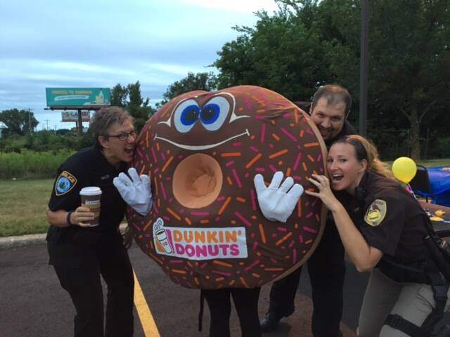 Dunkin Donuts Cop On A Rooftop For Special Olympics