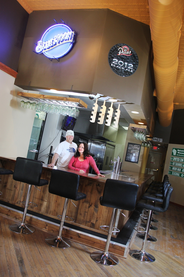 NOT BOTTLED UP. Newlyweds Andy Olson and Liane Edixon-Olson will soon open Splash Wine Bistro, 416 Water St., in a space that formerly housed Chedd's Gourmet Grilled Cheese.