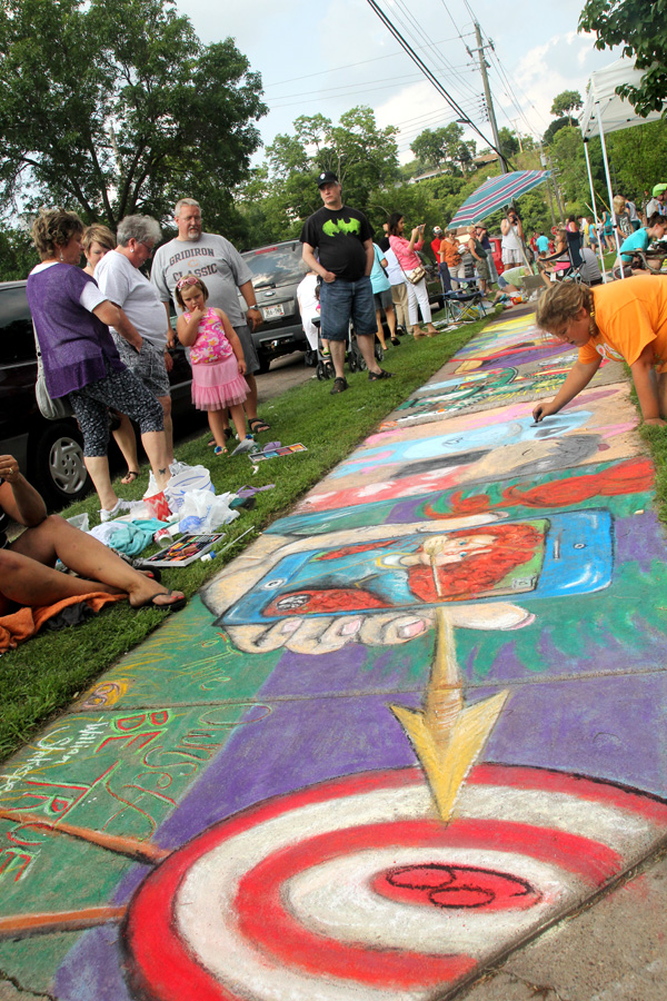 CHALKING UP ANOTHER YEAR. Nearly 150 artists and thousands of connoisseurs of concrete art descended on Wilson Park in downtown Eau Claire on Saturday, Aug. 2, for Volume One's annual Chalkfest. Check out VolumeOne.org for a list of winners and a full photo gallery.