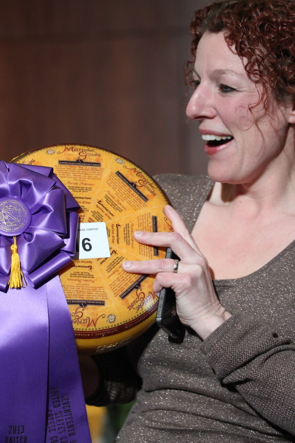 Marieke Penterman shows off her national champion cheese at last year's U.S. Cheese Championship in Green Bay