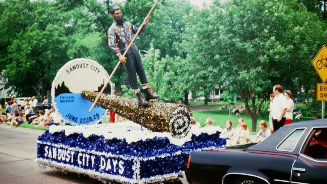 You see kids, in the olden days, lumberjacks used to ride giant Swiss Cake Rolls right down the Mighty Chip' to the Cake Roll Mill. Just kidding. Man, you don't see that kind of parade float craftsmanship around here any more. (Photo from Bob Gruen.