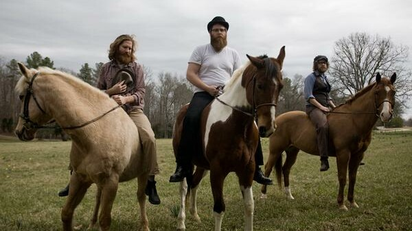 The now defunct Megafaun's former Eau Clairians Joe Westerlund, Brad Cook, and Phil Cook, shown here straddling unnamed equestrian companions.