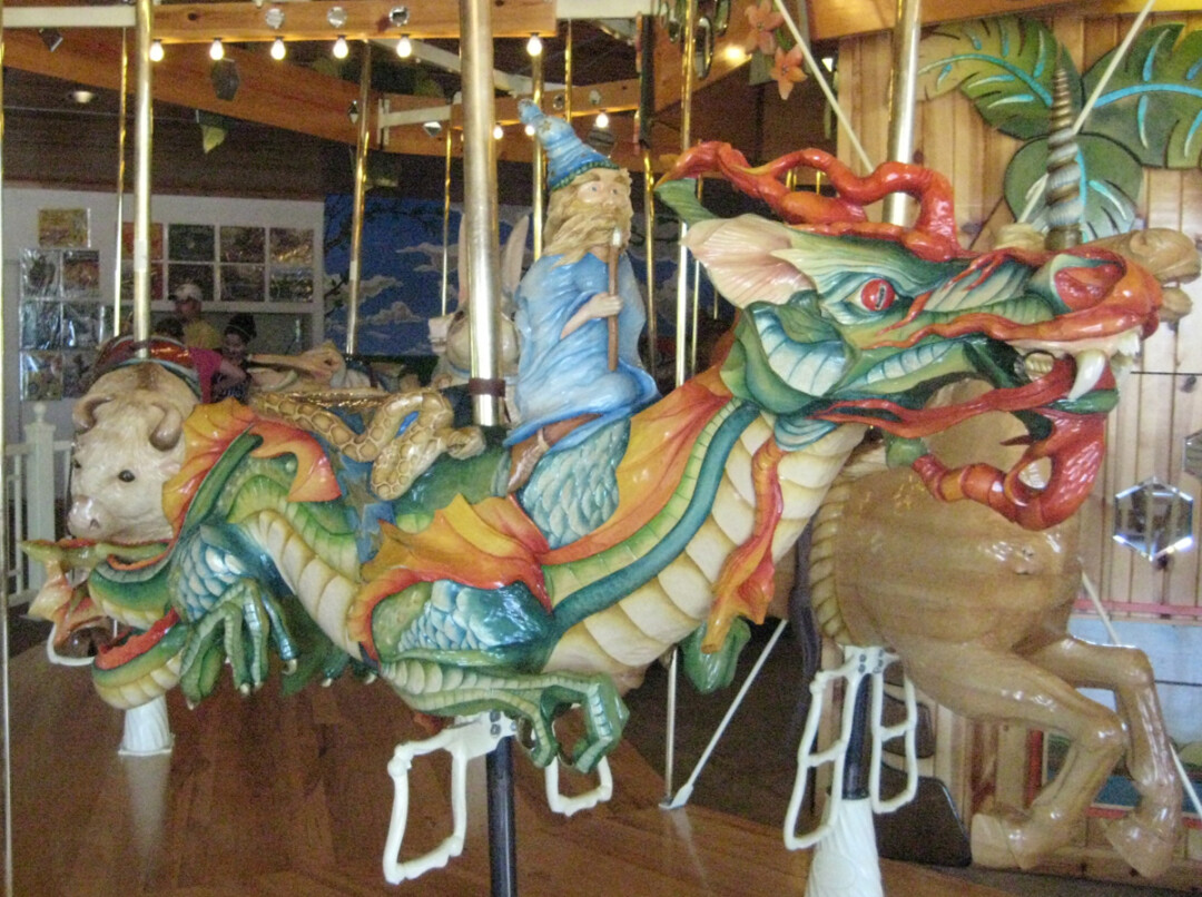 You're looking a wooden carousel dragon, handmade on-site at LARK Toys.