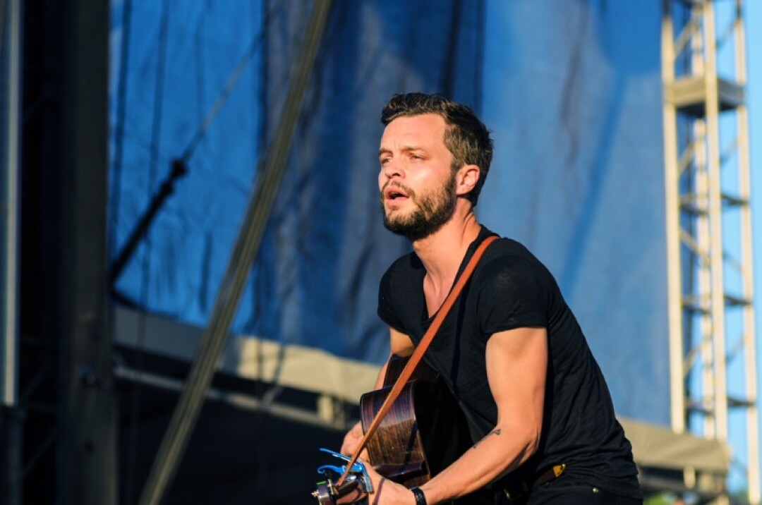 AW HE AIN'T THAT TALL. Kristian Mattson, a.k.a. The Tallest Man on Earth, brought a full band to last year's Eaux Claires festival, which includes local musicians Ben Lester (Aero Flynn), Mike Noyce (Bon Iver), and Zach Hanson (S. Carey). Photo credit: Lee Butterworth