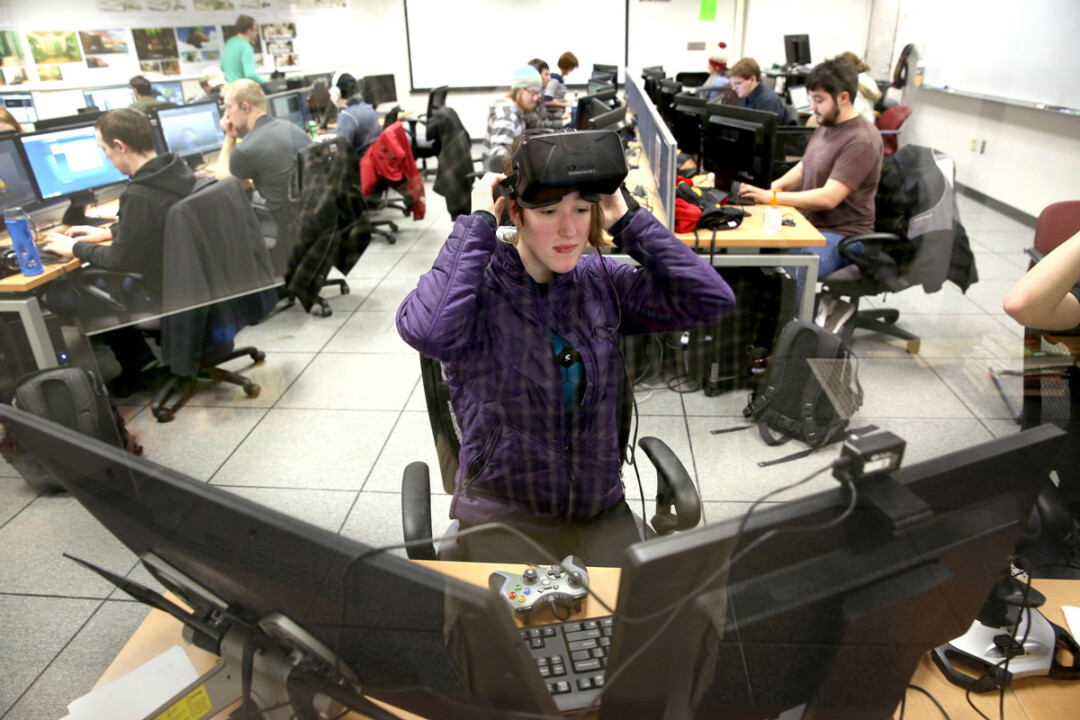 Emily Dillhunt, a senior majoring in game design and development, uses a virtual reality headset while working in a UW-Stout design lab. The game design program has been ranked 21st in the U.S. and Canada by Princeton Review.