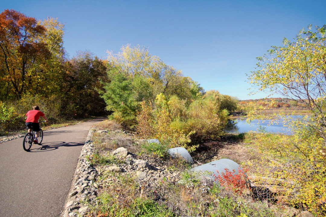 PEDAL PUSHER. Users of the Chippewa River Trail, shown above, will be able to bike all the way to Chippewa Falls – and beyond – when the final gap in the adjacent Old Abe State Trail is completed as early as 2018.