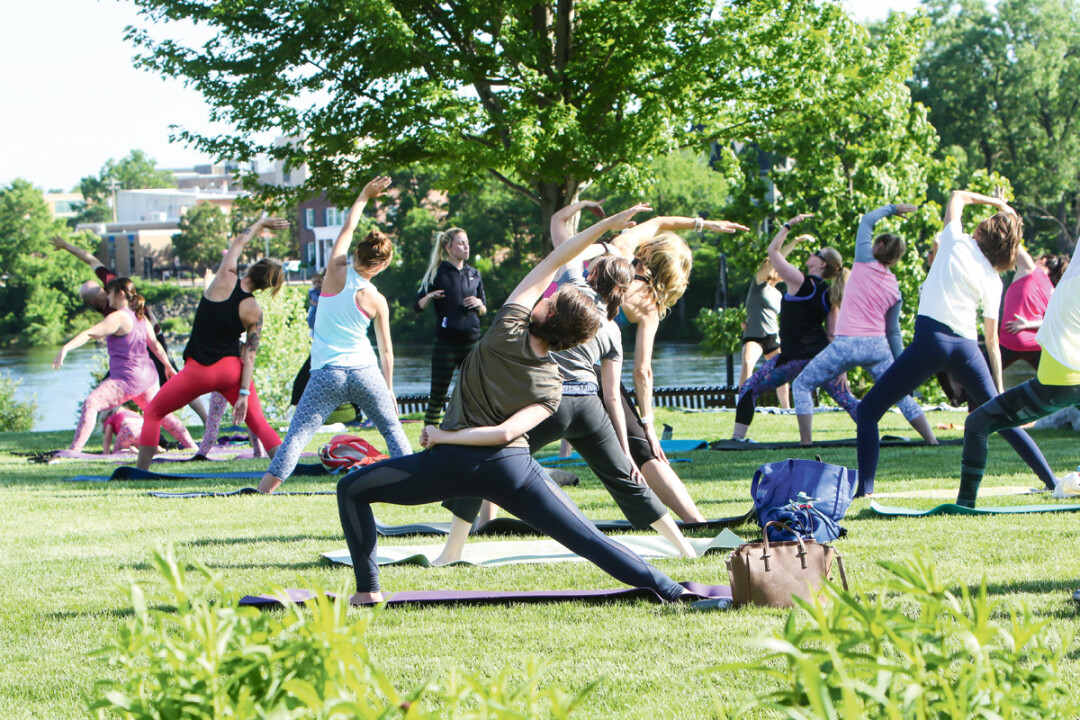 High-five free yoga is a peaceful outdoor yoga gathering in Eau Claire's Phoenix Park with sessions on Thursday nights before the Sounds Like Summer Concert Series and Saturday mornings during the Artist Market.