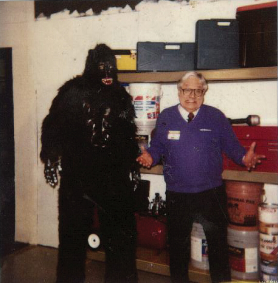 Ray Szmanda on set at a Menards commercial shoot for Gorilla Rack Shelving, circa 2001. Volume One owner/publisher Nick Meyer is the guy in the gorilla suit – it was his job to jump into the frame, hop up and down, and pound his chest. Ray had plenty of monkey jokes for the crew.