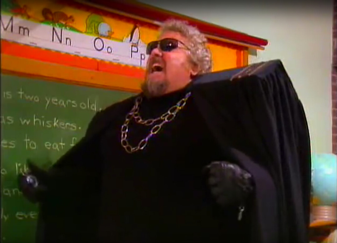 Larry Laird as the evil Storylord Thorzuul, a caped, sunglasses-rocking villain, shown here in anguish. Image: